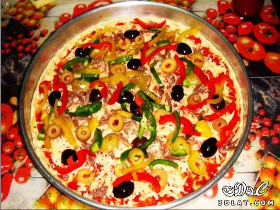 طريقة عمل البيتزا سهلة جداا عندنا وبس  129948184618