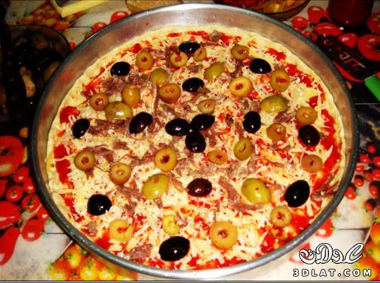 طريقة عمل البيتزا سهلة جداا عندنا وبس  129948184619