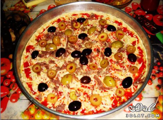 طريقة عمل البيتزا سهلة جداا عندنا وبس  129948184720