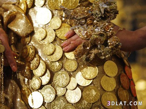 فستان مصنوع الذهب عيار بقيمة مليون 13663082151.jpg