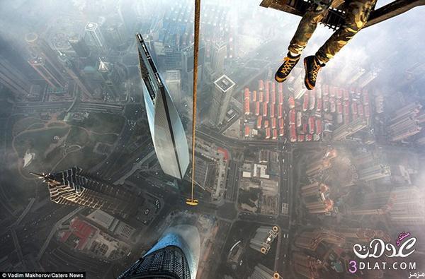 مغامران تسلقا شنغهاي أعلى مبنى
