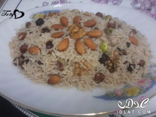 الأرز بالمكسرات بالصور طريقة الأرز بالمكسرات 3dlat.com_1409077168
