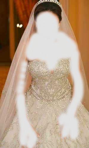 ساتين زفاف فخمه  2015 ,مرصعة بالكريستال والؤلؤ  3dlat.net_13_15_1611_Egypttoday-tsmeem6
