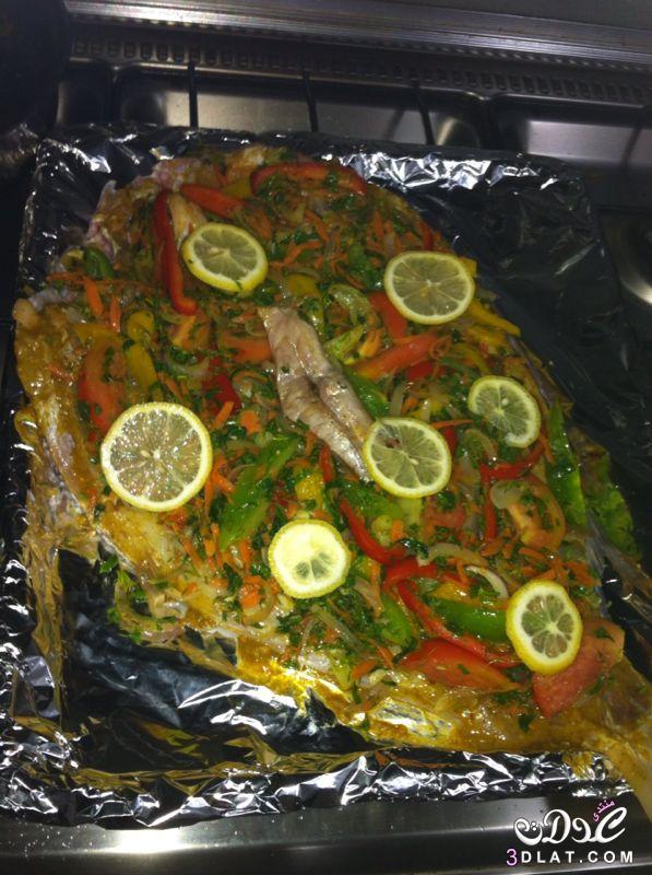 سمك مشوى بتتبيلة الثوم والليمون طريقة اعداد سمك مشوى بتتبيلة الثوم والليمون 3dlat.net_14_15_52a1