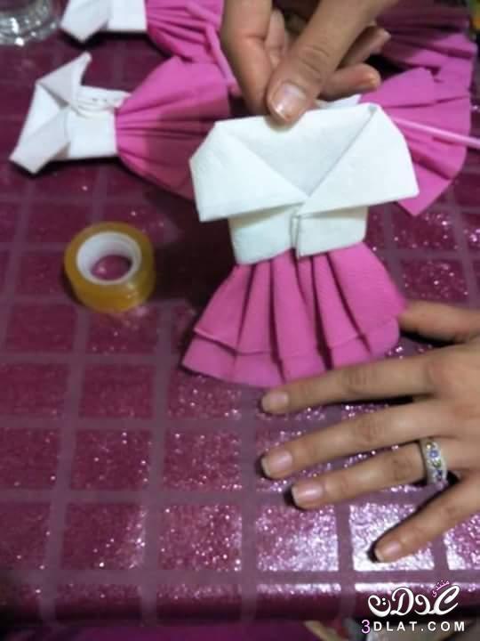 طريقة طي المناديل على شكل فستان صغير